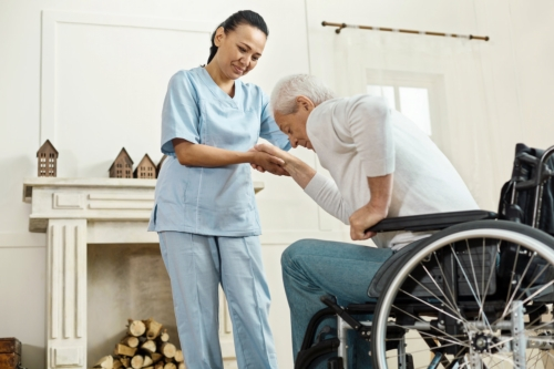 caregiver and elderly man